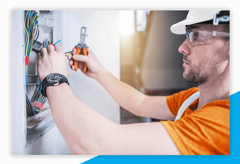 electrician fixing wires inside electrical box