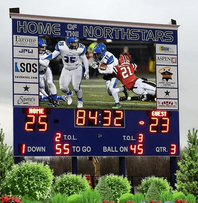 LED scoreboard and video screen at football field